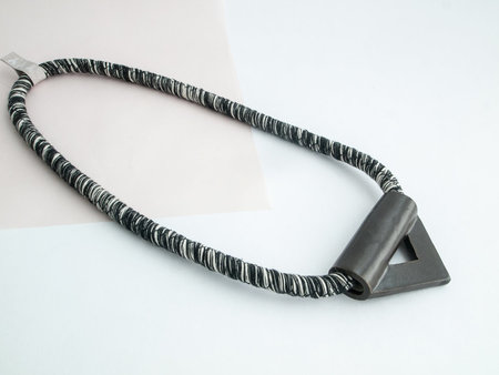 YYY black triangle necklace on variegated cord