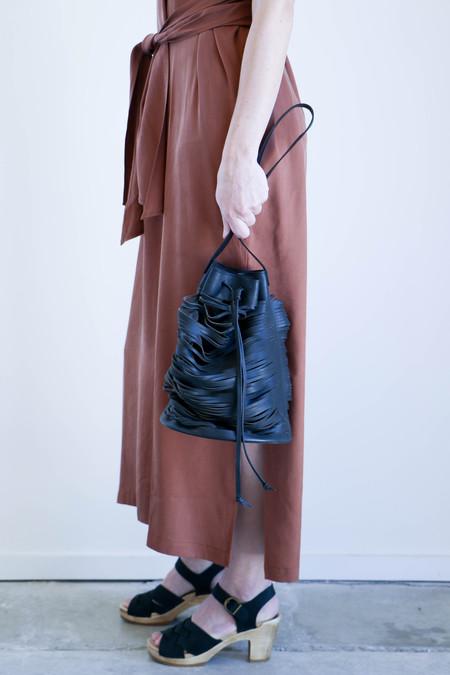 Modern Weaving Laser Cut Lines Bucket Bag in Black