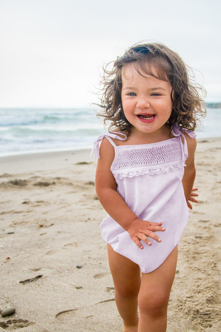 Kids Petit Mioche hand-smocked playsuit - light pink