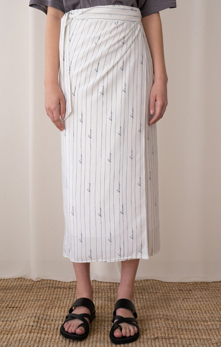 AMONG SEOUL STRIPE WRAP SKIRT - IVORY