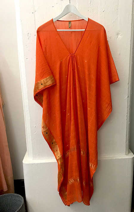 Two orange caftan with metallic details