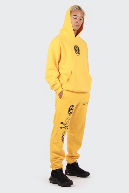 PLEASURES Dead Crew Sweatpants - gold